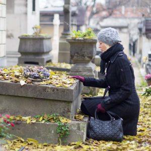 Woman visiting gravesite