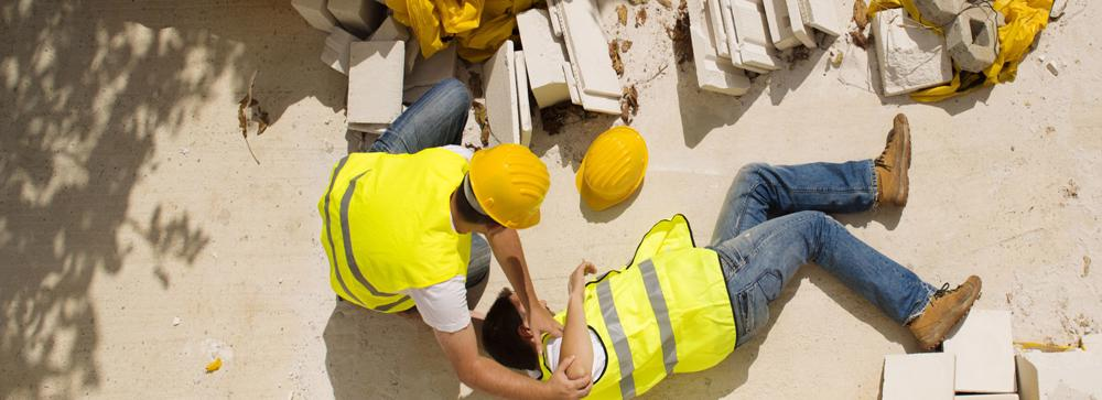 This image shows a construction worker unconscious after a workplace injury.