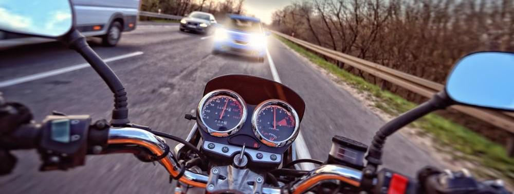 This image shows an impending motorcycle accident from the riders perspective.