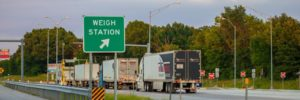 This image shows semi-trucks at an interstate weigh station.