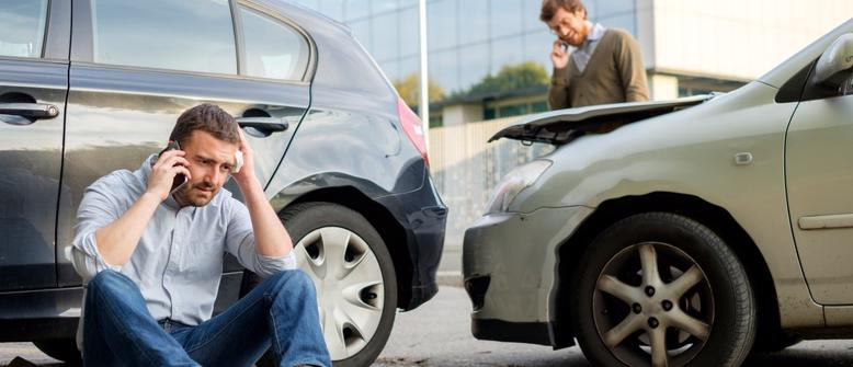 Twp men on the phone with their Alabaster car accident lawyer after an accident occurred.