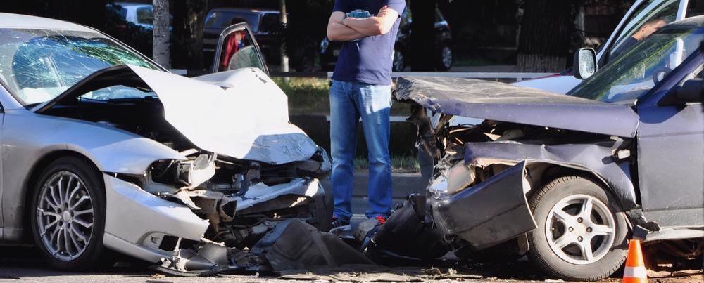 Man observing a multi-car accident scene in Randolph, AL