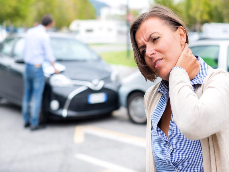 A woman holding her neck after a car accident in Trussville, AL