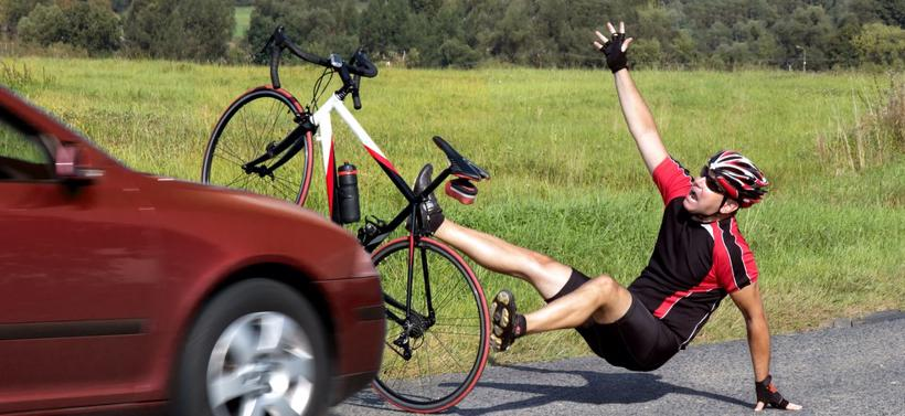 A man falling off his bicycle after being struck by a car in Alabaster, AL
