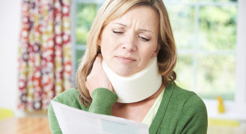 Women holding her injured neck while negotiating with a personal injury lawyer in Bessemer, AL