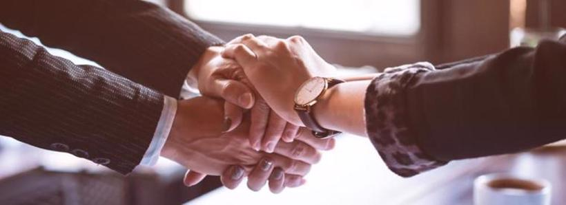 Client shaking hands with their Cullman personal injury lawyer after their case was settled