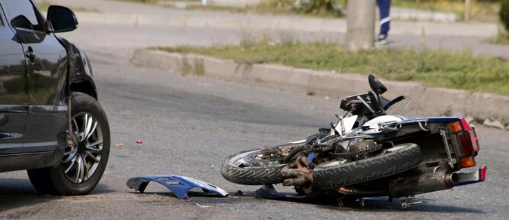 Motorcycle lying on the ground after an accident in Moody, AL