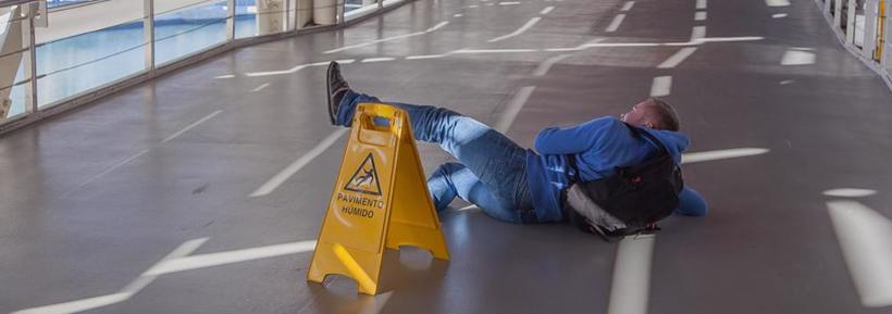 Man lying on the floor after a slip and fall accident in Sylacauga, AL