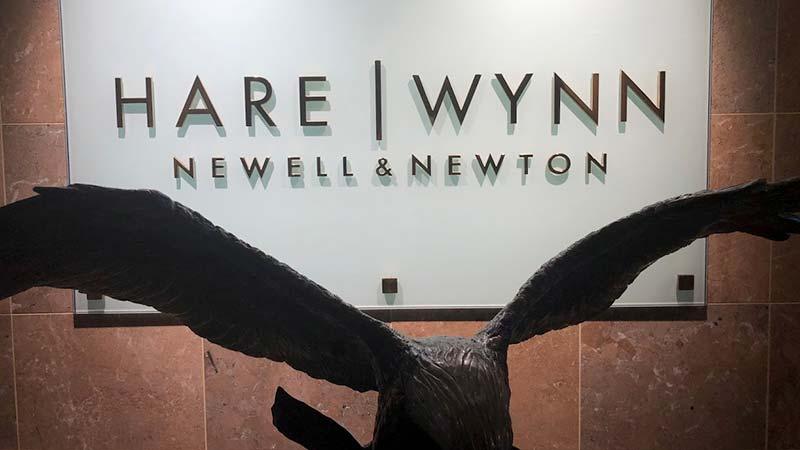 HWNN wall logo in office
