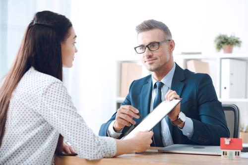 A woman meeting with a Birmingham whiplash injury lawyer.