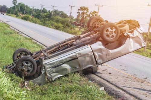 A truck upside down on the side of a road. Contact a Birmingham rollover accident lawyer.