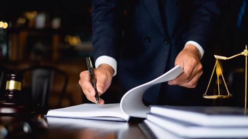 A lawyer filing a qui tam action for a client.