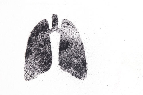 silhouette of human lungs from coal dust on a white background, black lung disease concept