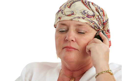 A woman, bald from chemotherapy, calling about Birmingham Taxotere lawsuit