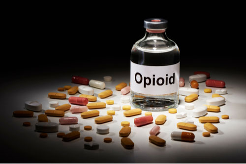 Ampoule Opioid surrounded by many tablets. Birmingham Opioid lawsuit concept