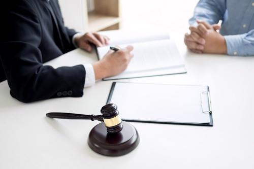 A Birmingham defective medical device lawyer reviewing a claim with a client.