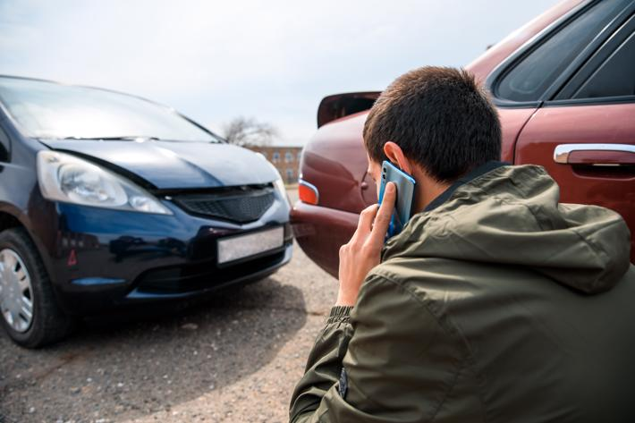 A man calling a Homewood car accident lawyer after being rear-ended.