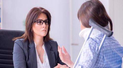 A woman discussing a claim with a Homewood personal injury lawyer.