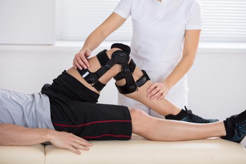 A man having a knee injury treated.