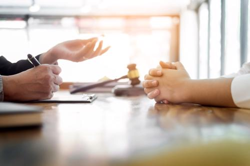 An attorney negotiating an injury settlement for a client.