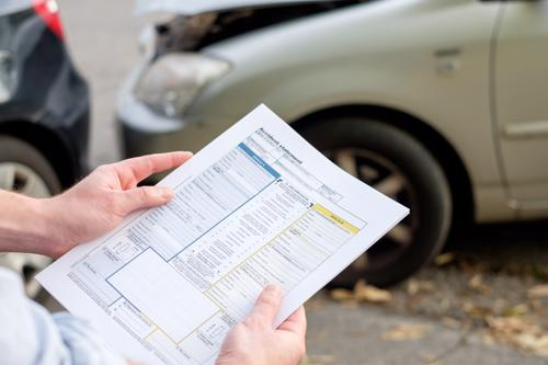 An insurance adjuster reviewing a car accident.
